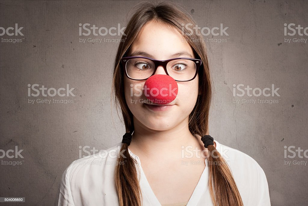 happy young girl with a clown nose stock photo