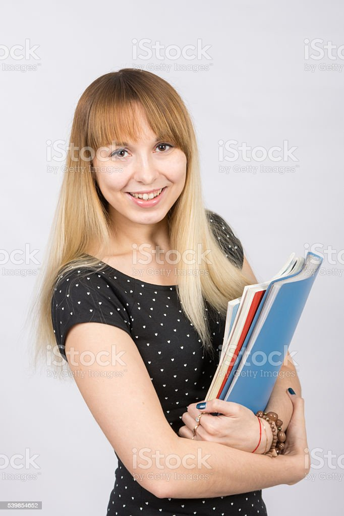Happy young girl with a folder in his hands happily stock photo