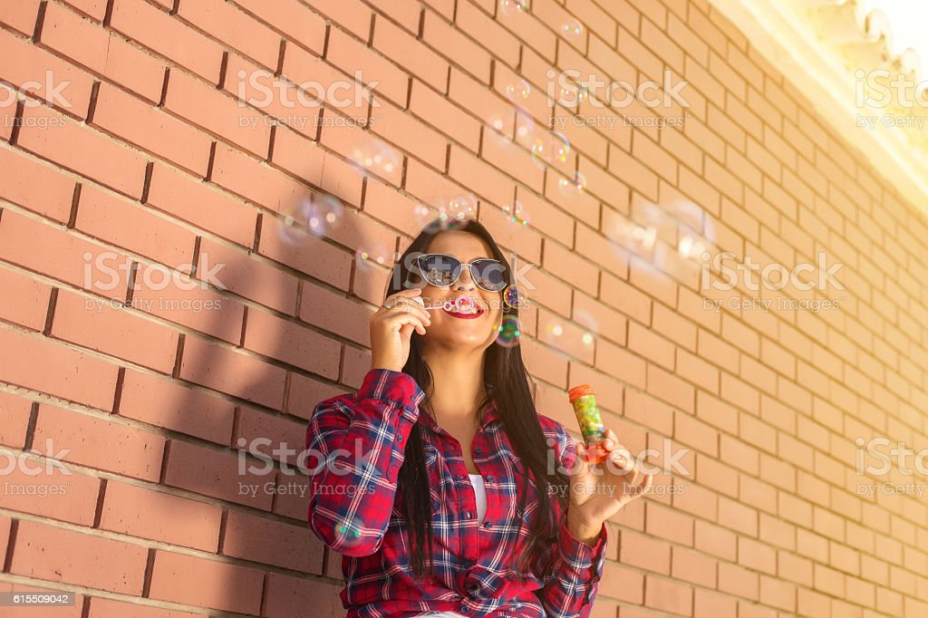 Happy young girl with bubbles stock photo