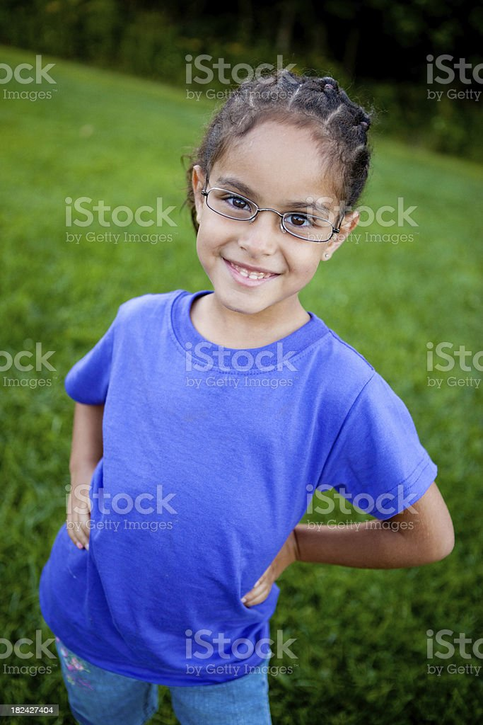 Happy Young Girl with Glasses Smiling Outside royalty-free stock photo
