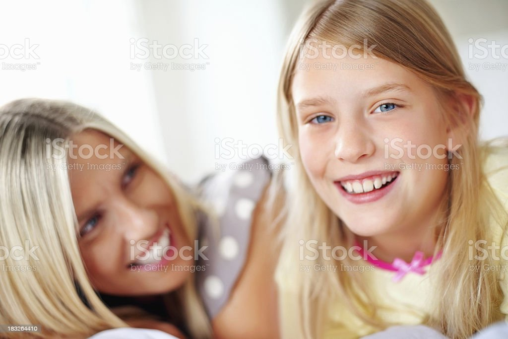 Happy young girl with her mother, smiling royalty-free stock photo