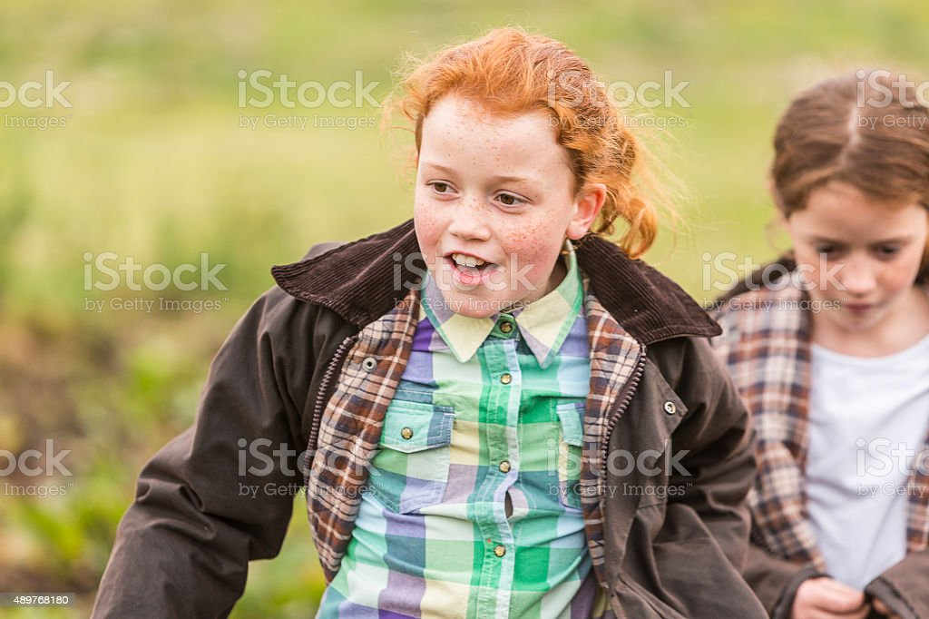 Happy Young Girls Running on a Farm stock photo