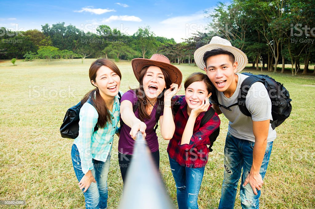 happy young group making selfie by  smart phone stock photo