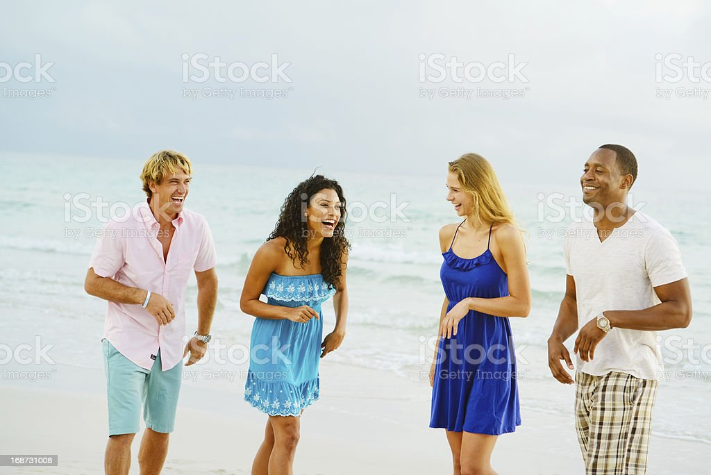 Happy Young Group of Friends Having Fun on the Beach royalty-free stock photo