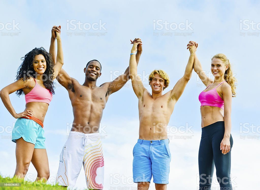 Happy Young Group of Friends Holding Hands royalty-free stock photo