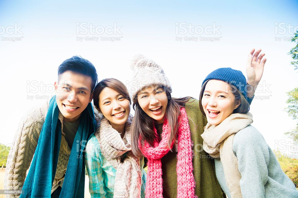 happy young group with winter wear stock photo