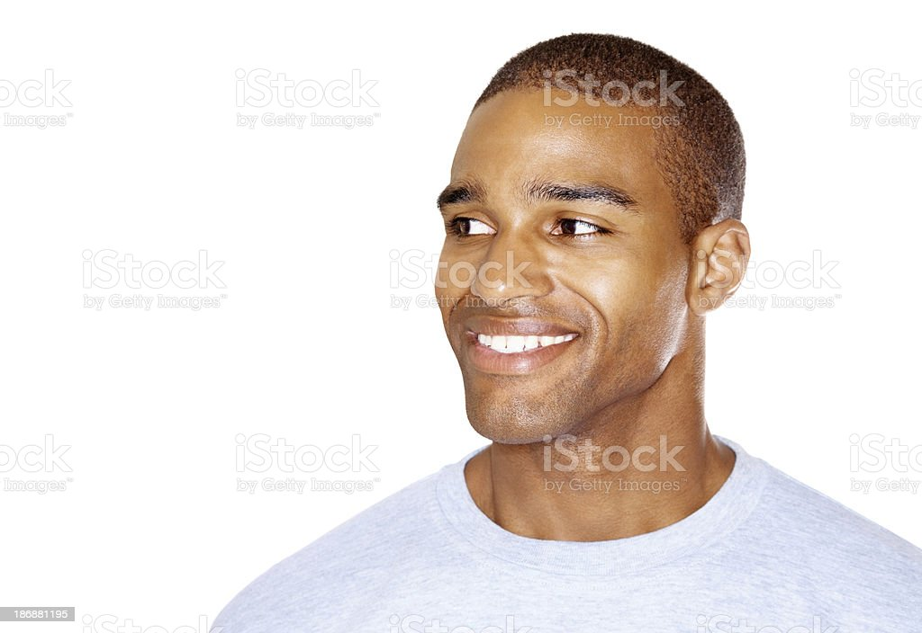 Happy young guy looking at copyspace against white royalty-free stock photo