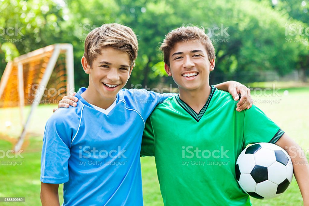 Happy young guy soccer players hanging out together stock photo