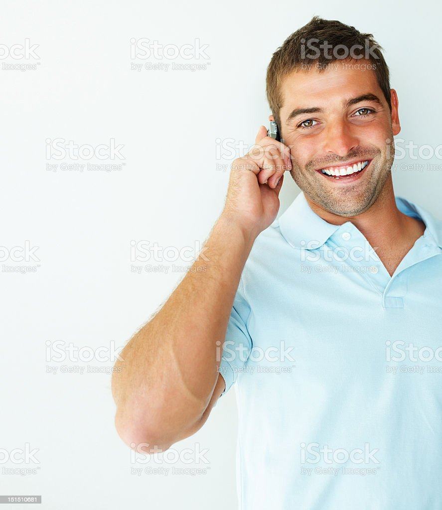 Happy young guy talking on a cellphone royalty-free stock photo