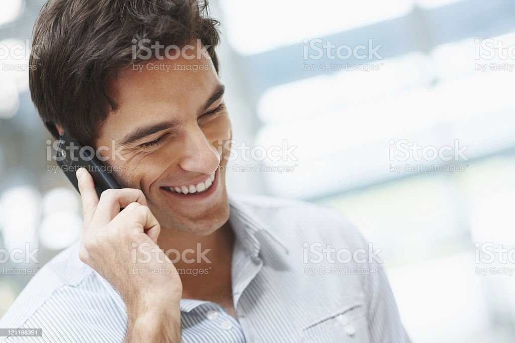 Happy young guy talking over cellphone royalty-free stock photo