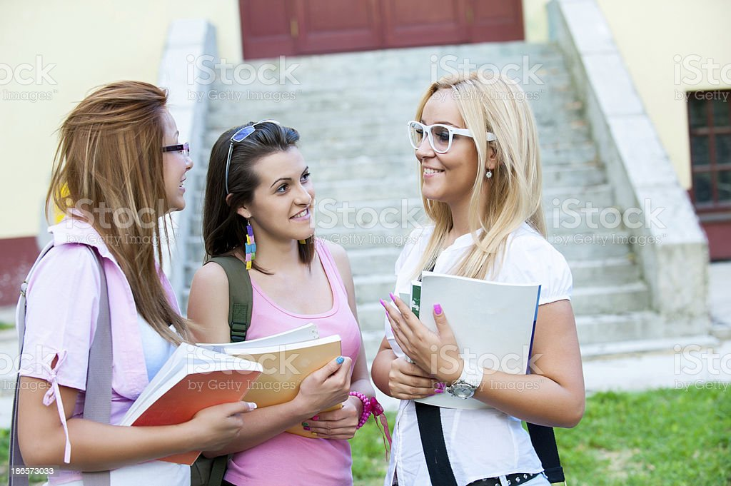 happy young high school students or gollege girls royalty-free stock photo