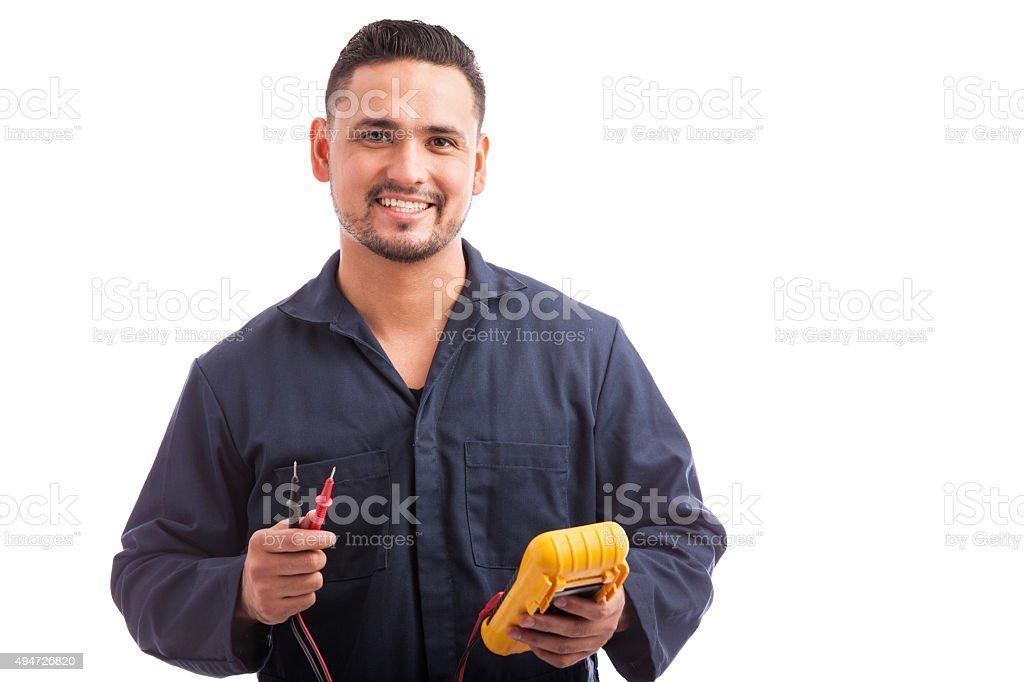Happy young Hispanic electrician stock photo