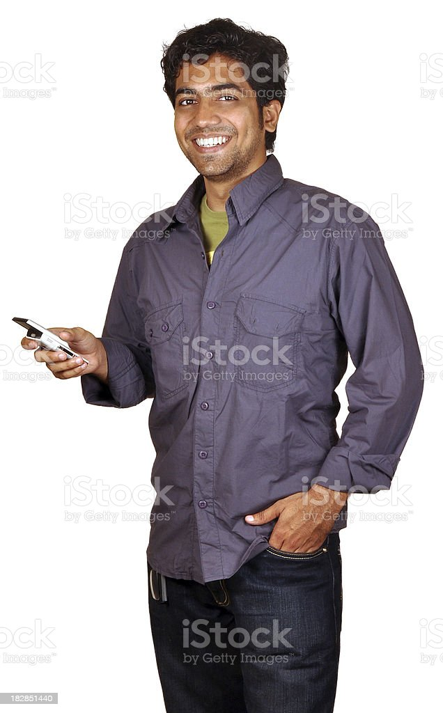 Happy Young Indian Man Holding A Cellphone & Smiling royalty-free stock photo