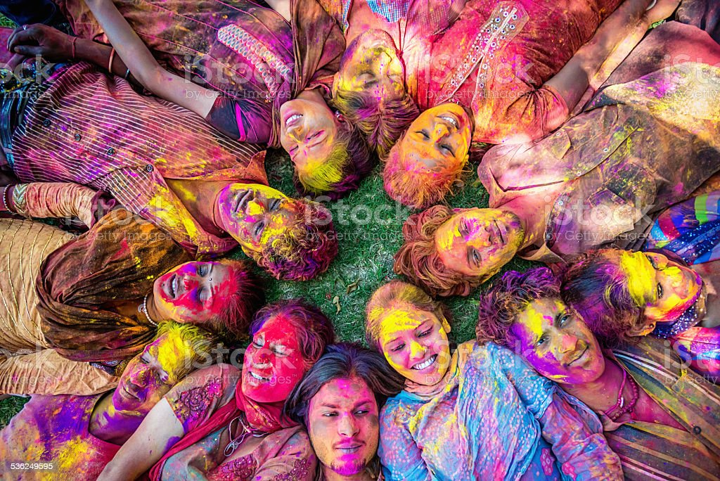 Happy Young Indian People Celebrating Holi Festival stock photo