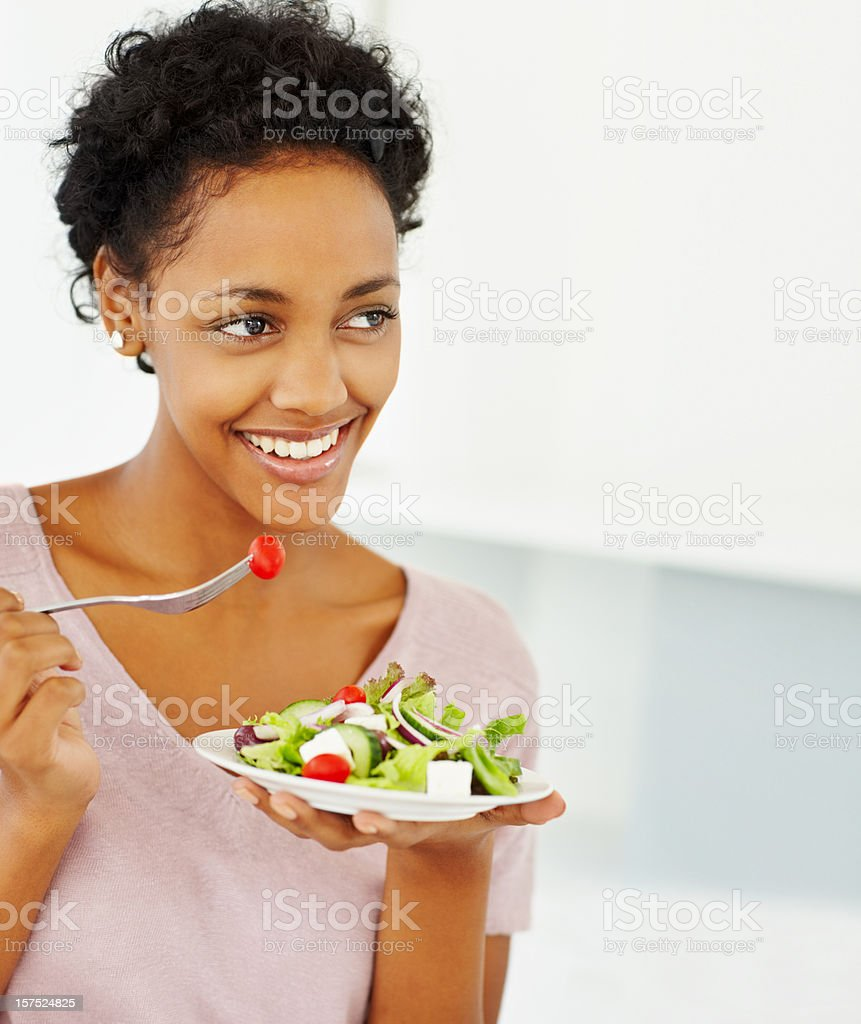Happy young lady eating salad royalty-free stock photo