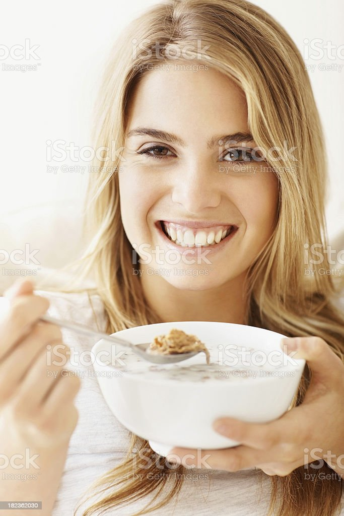 Happy young lady having breakfast royalty-free stock photo