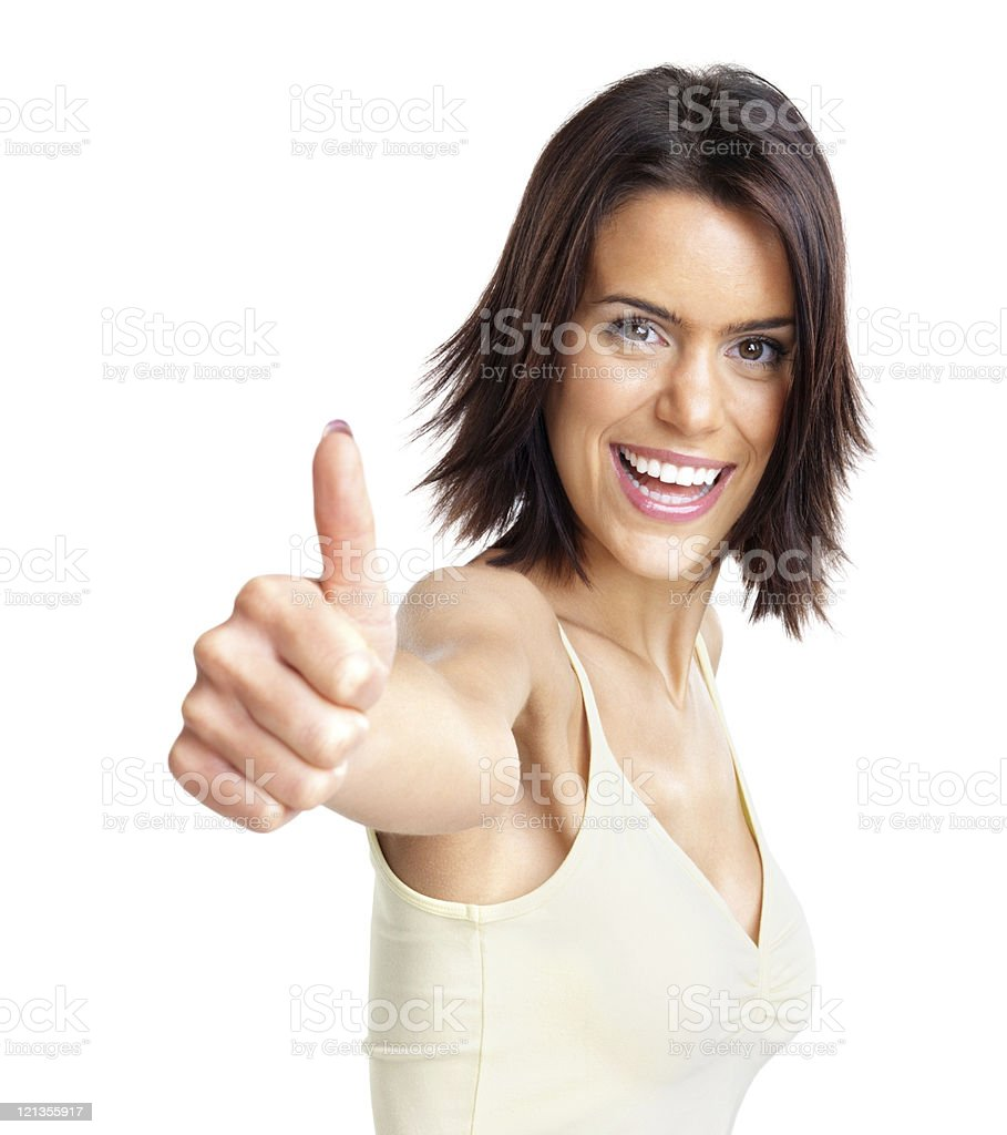 Happy, young lady showing thumb up sign stock photo