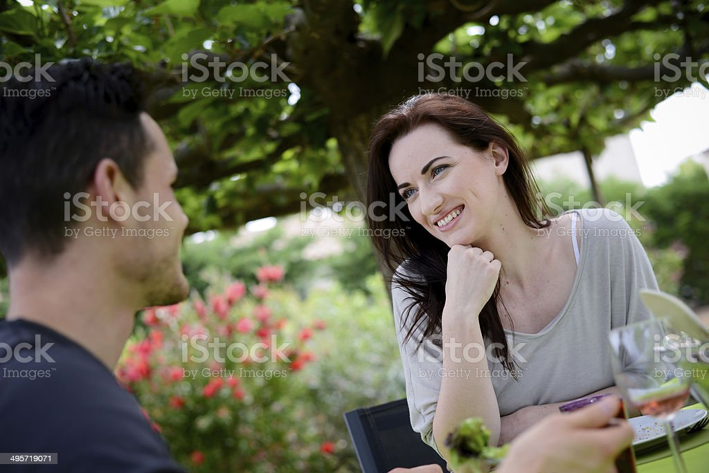 happy young loving couple having lunch barbecue party outdoor garden stock photo