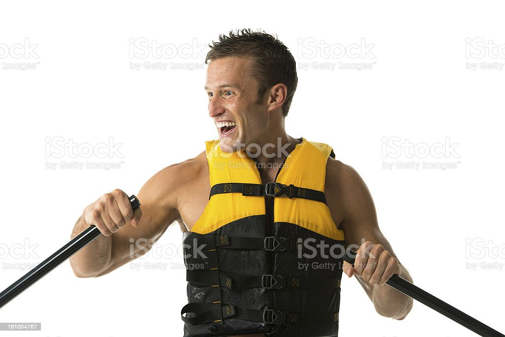 Happy young man canoeing royalty-free stock photo