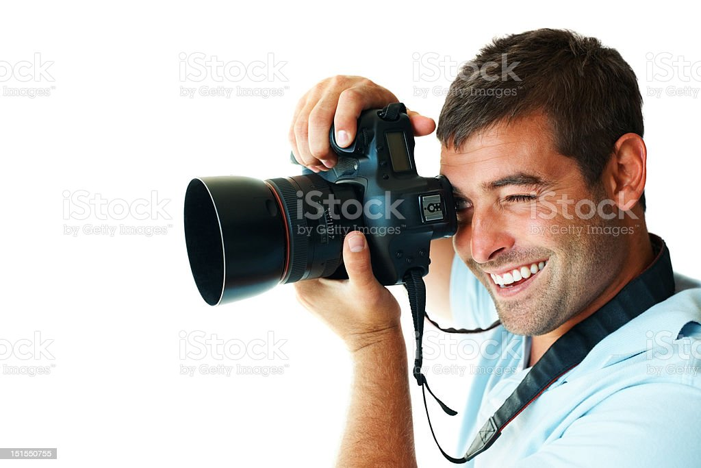 Happy young man clicking photo from camera royalty-free stock photo