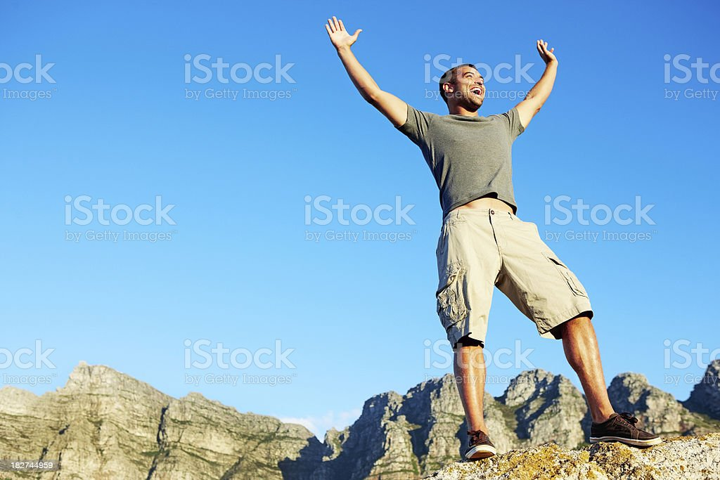 Happy young man enjoying vacation with copy space royalty-free stock photo