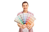 Happy young man holding a color swatch