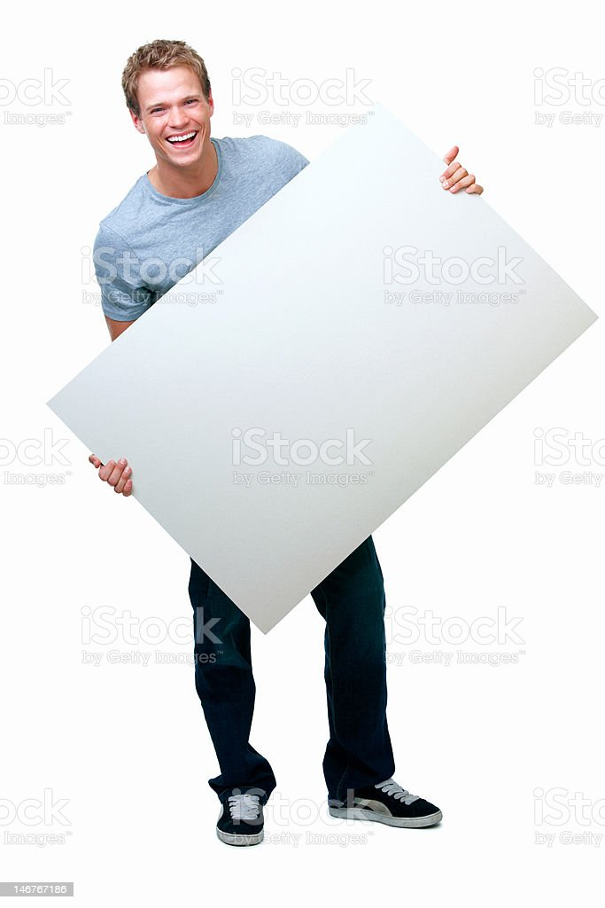 Happy young man holding blank placard against white background royalty-free stock photo