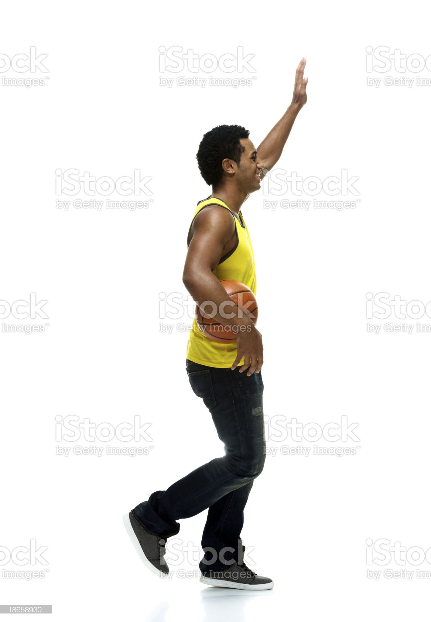 Happy young man holding with basketball royalty-free stock photo