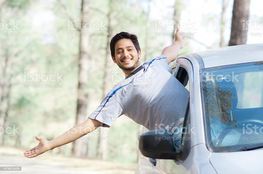 Happy young man in a Car stock photo