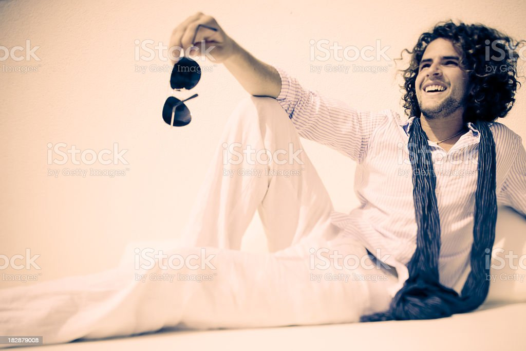 Happy young man in casual summer clothes relaxing stock photo