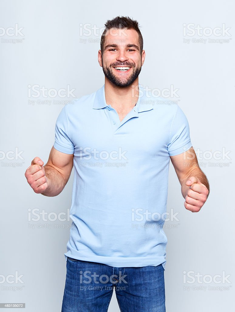 Happy young man in polo shirt stock photo