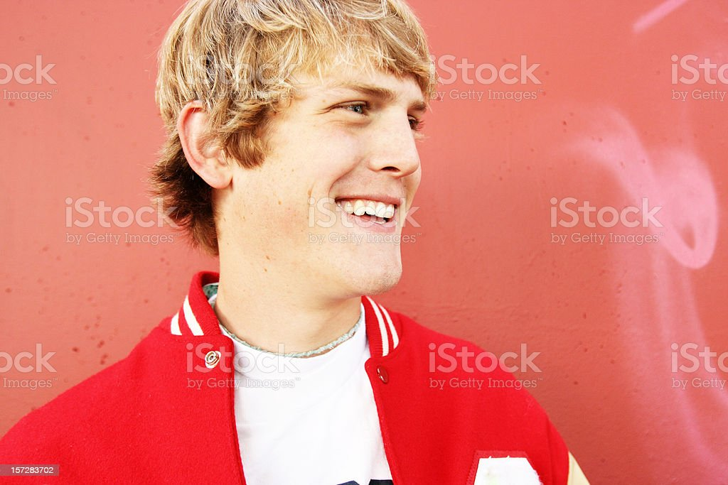 Happy Young Man in Red Jacket stock photo