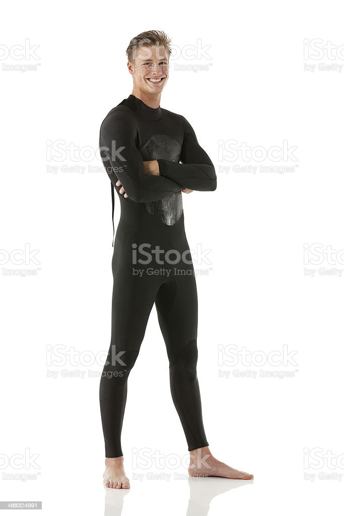 Happy young man in wet suit stock photo