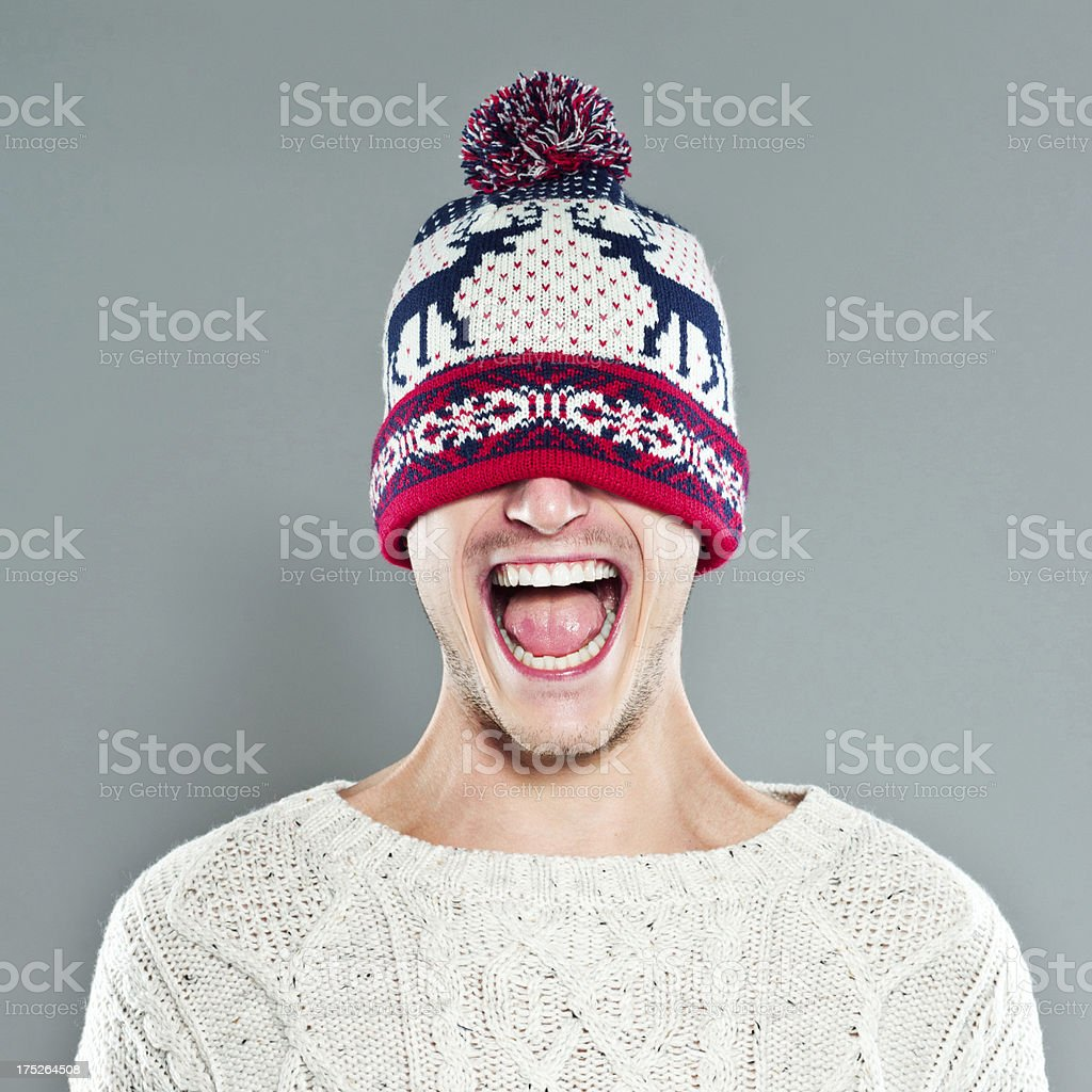 Happy Young Man in Winter Cap stock photo