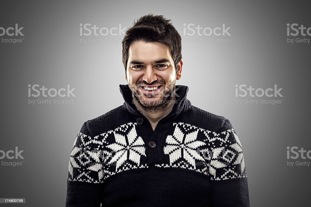 Happy young man in winter clothing royalty-free stock photo