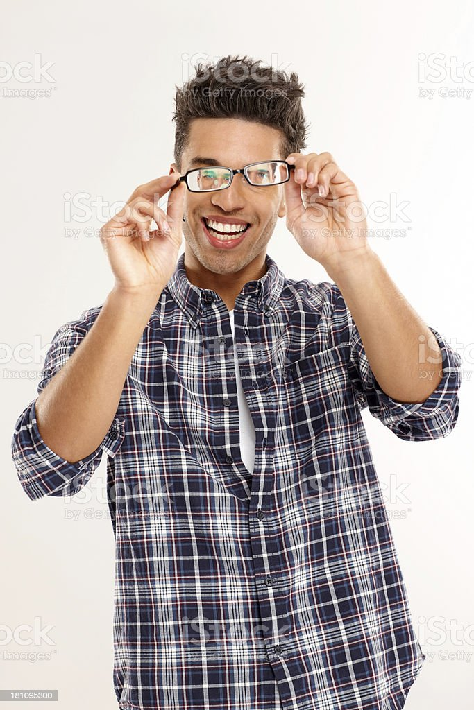 Happy young man inspecting his glasses royalty-free stock photo