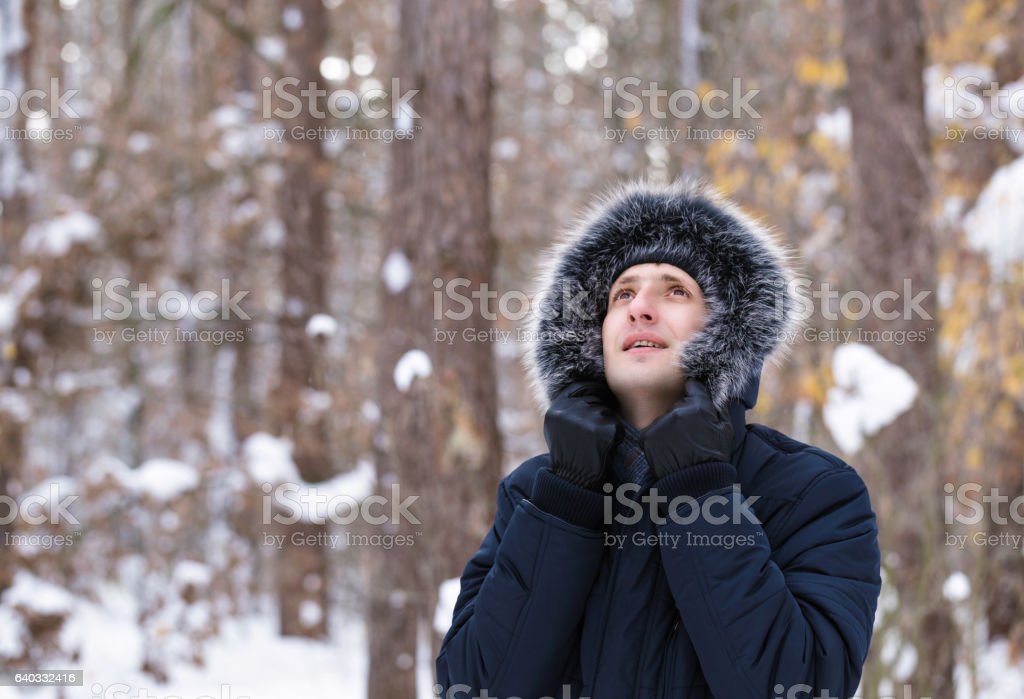 Happy young man is looking at the sky. stock photo