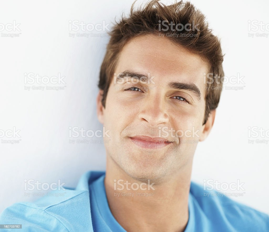 Happy young man isolated against white background royalty-free stock photo