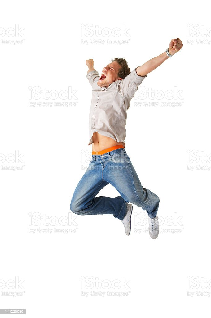 Happy young man jumping on an isolated background royalty-free stock photo