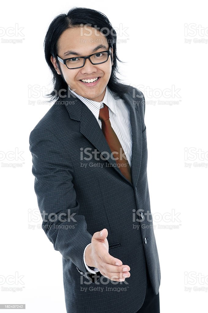 Happy young man offering for handshake stock photo