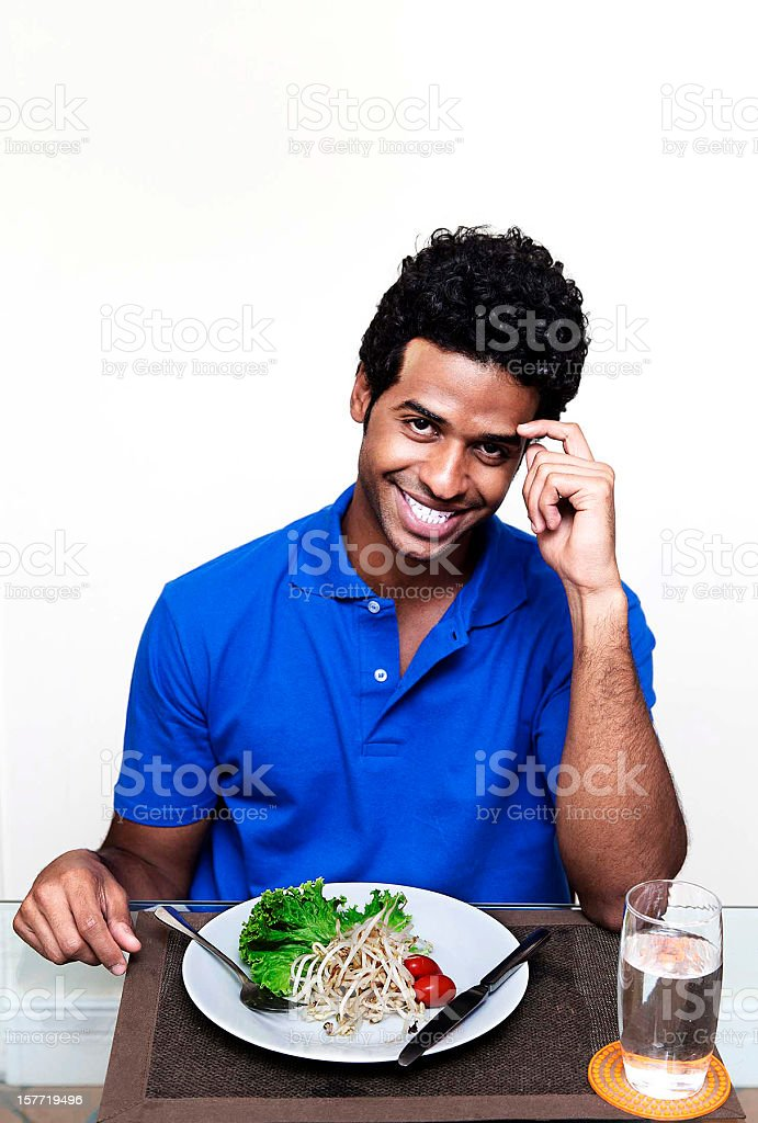 Happy young man on a diet royalty-free stock photo
