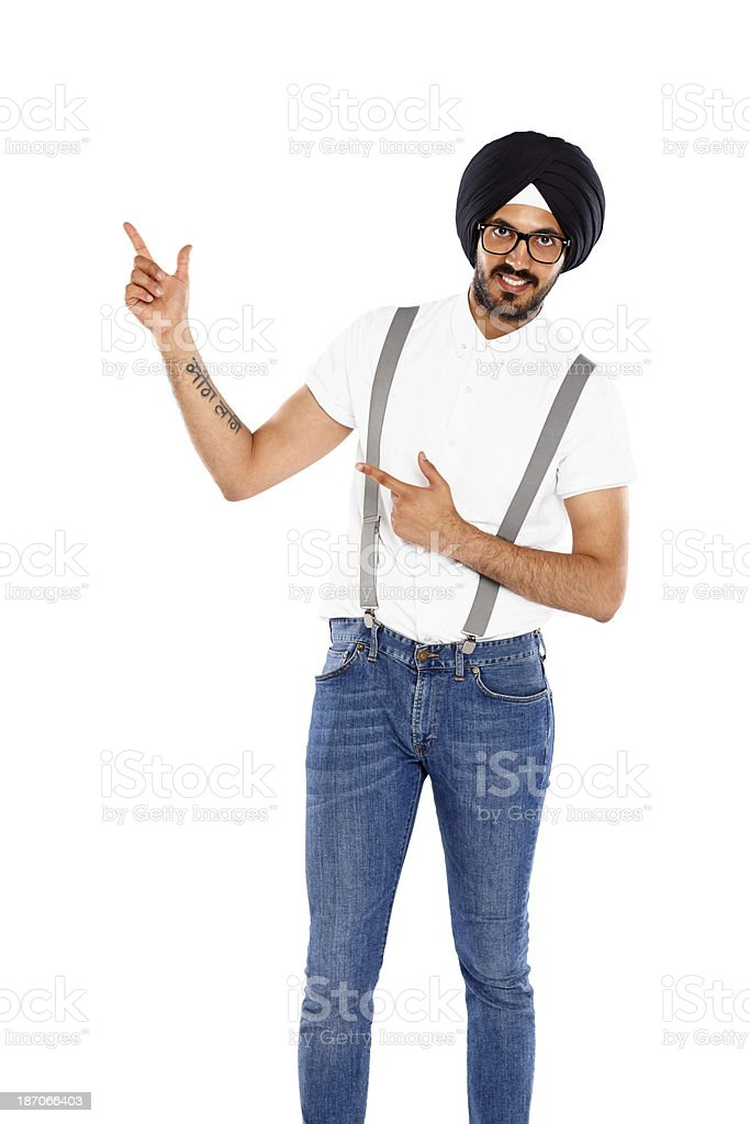 Happy young man pointing at empty space for advertisement royalty-free stock photo