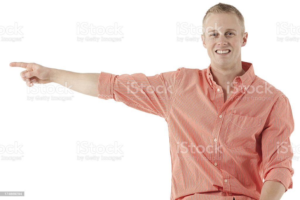 Happy young man pointing royalty-free stock photo