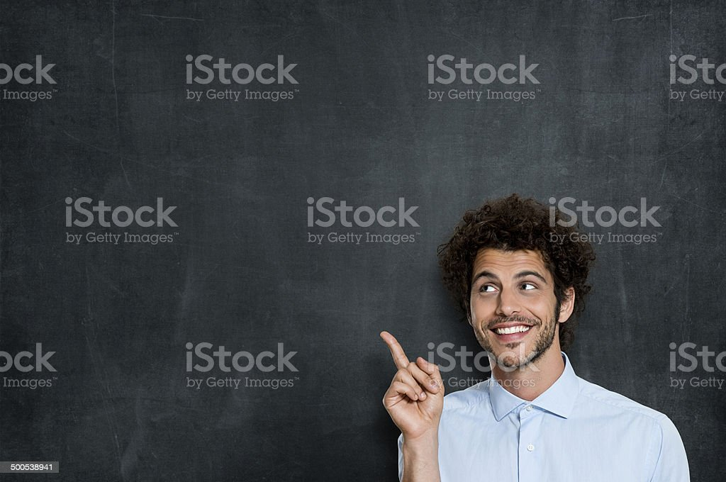 Happy Young Man Pointing stock photo