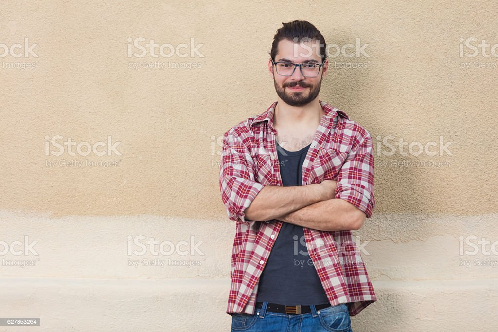 Happy young man posing in front of the camera. stock photo