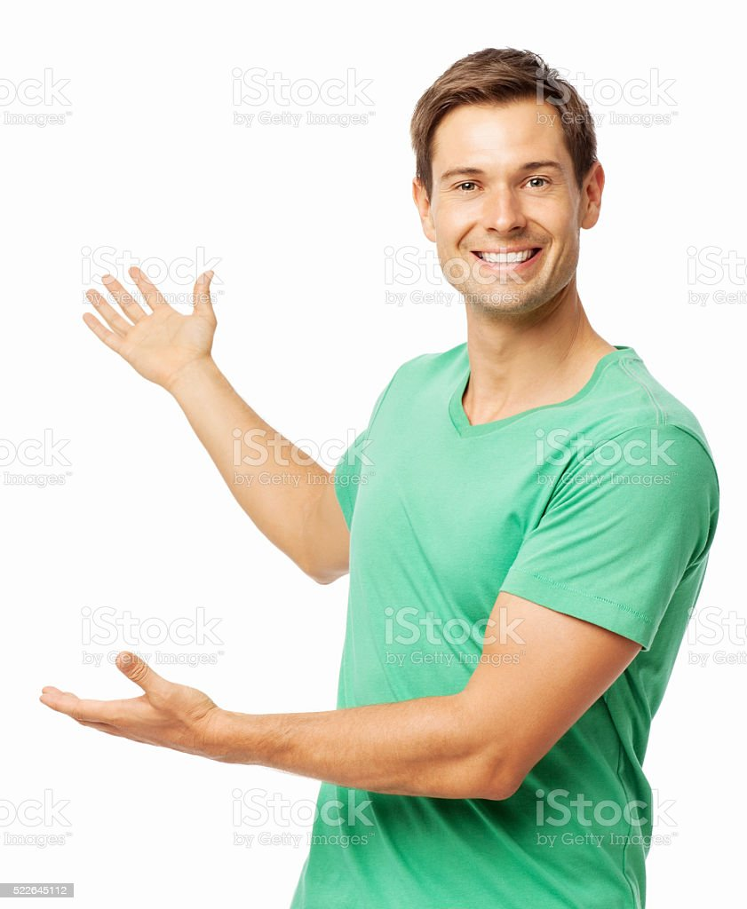 Happy Young Man Showing Copy Space stock photo