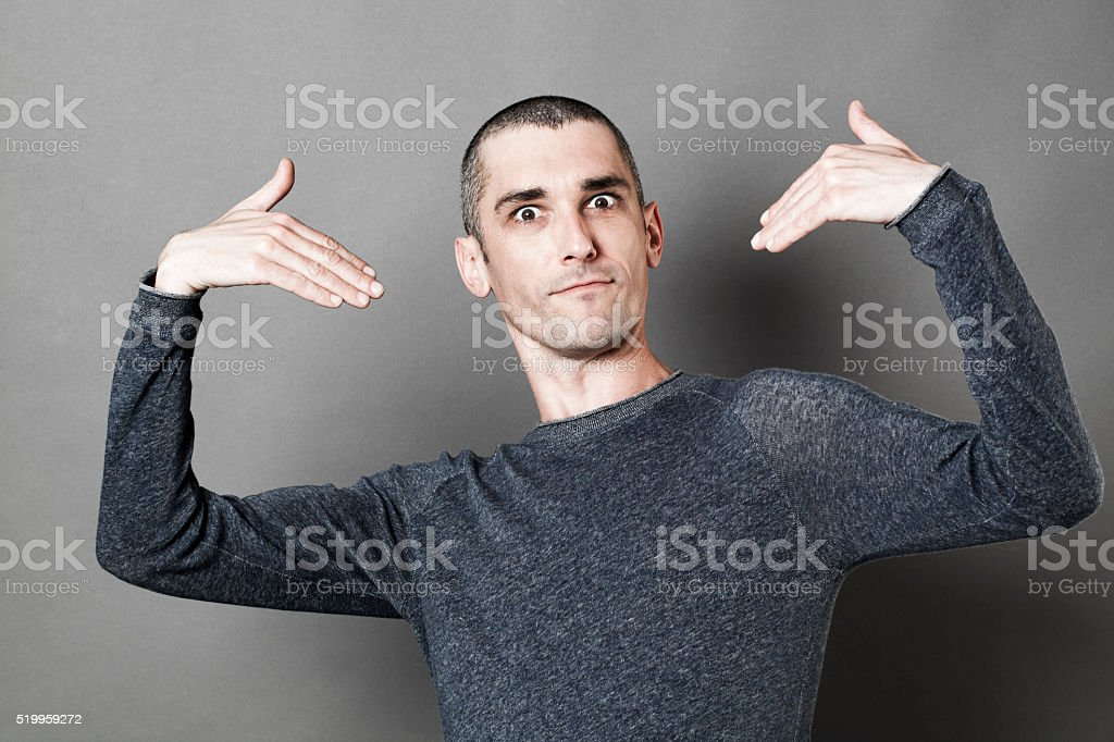 happy young man showing or picking himself responsible stock photo