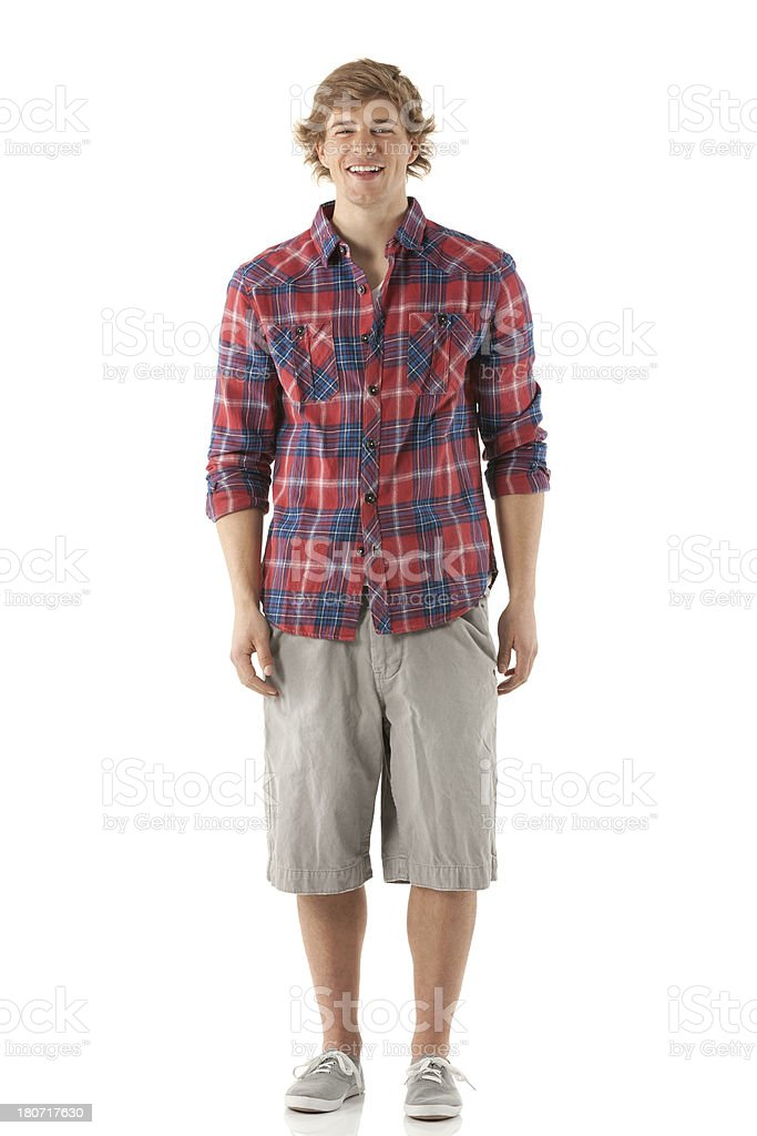 Happy young man standing royalty-free stock photo