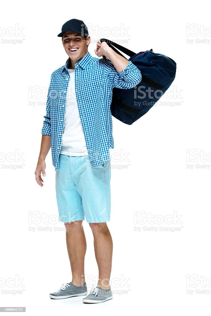 Happy young man standing with duffle bag royalty-free stock photo