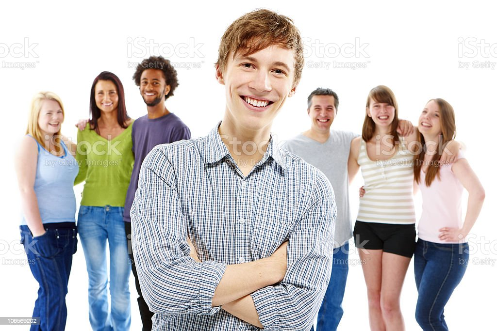 happy young man standing with friends in background royalty-free stock photo